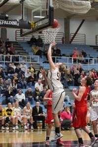 Karina Schroeder goes up for a layup over a pair of Saint Ben's posts.