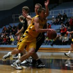 Brody Ziegler drives by a St. Olaf defender. (Photo courtesy of Brett Ylonen `15)