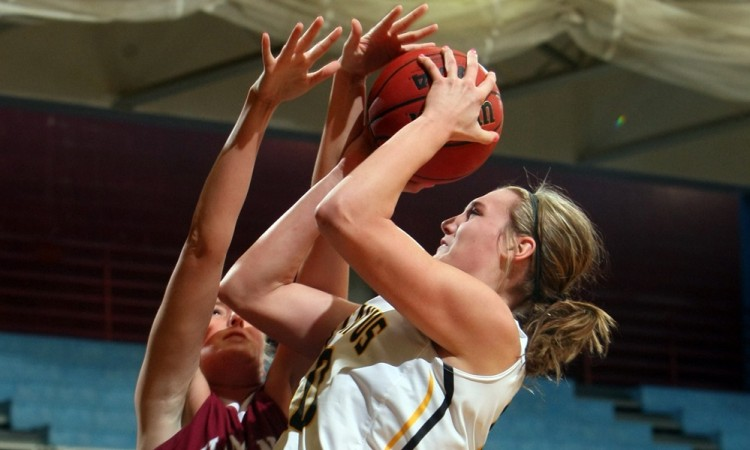 Karina Schroeder led the Gustavus women's basketball team on the blocks with 16 points in Saturday's win over Hamline.  Photo courtesy of Bridget Larson - Sport PiX.
