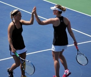 There were countless hi-fives - like this one between Sam Frank and Megan Gaard in 2011 - during Gustavus' incredible run. (Photo by Matt Higgins, MIAC)