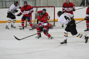 Jack Walsh attempts to get the puck through traffic with a shot from the left point.