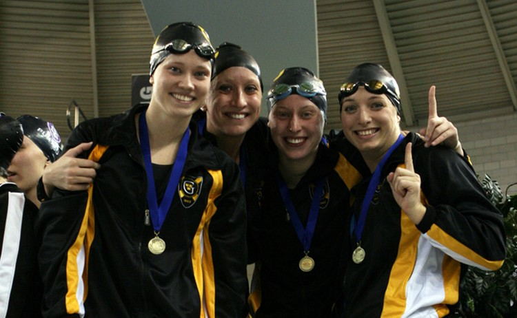 The record breaking 400-medley relay team of Katie Olson, Alissa Tinklenberg, Jennifer Strom, and Laura Drake on the podium after their win. Photo courtesy of Kim Hagemeyer.