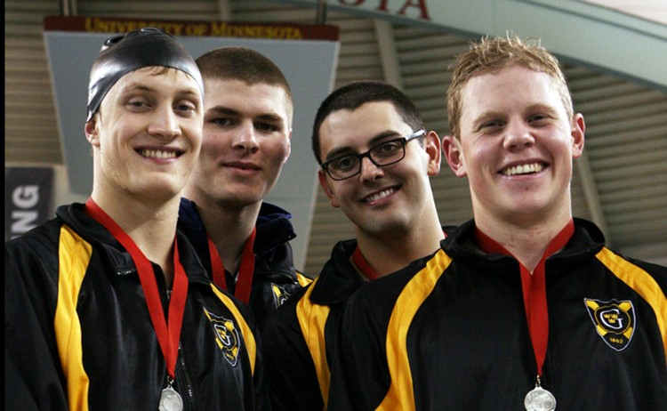The second place 400-medley relay team of Kurt Youngdahl, Dante Colucci, Jacob Stern, and Ross Larson on the podium. Photo courtesy of Kim Hagemeyer.