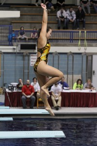 Heather Funai performs on the diving board. Photo courtesy of Kim Hagemeyer.