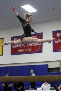 Senior Bailey Zeinert performs on the beam.