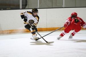 Leah Johnson skates by a Saint Mary's defender.