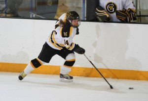 Melissa Doyle skates the puck up the ice.