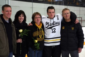 Andrew Petersen with his family for Senior Night after the game.