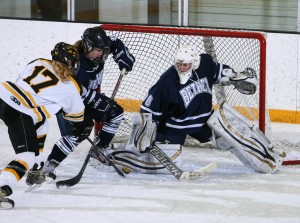 Lindsey Hjelm scores the game-winner. (Photo courtesy of A.J. Dahm - Sport Pix Photography)