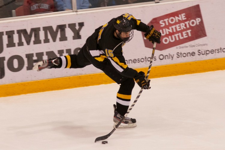 Adam Smyth shoots in in Gustavus' 3-2 loss to Saint John's in the MIAC Playoff Championship game. Photo courtesy of Jeff Hunt.