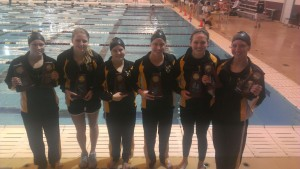 All six Gusties displaying their All-American awards