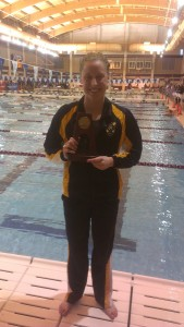 Jennifer Strom with her All-America trophy on Friday night.