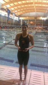 Alissa Tinklenberg with her All-America trophy after finishing sixth in the 200 backstroke on Saturday.