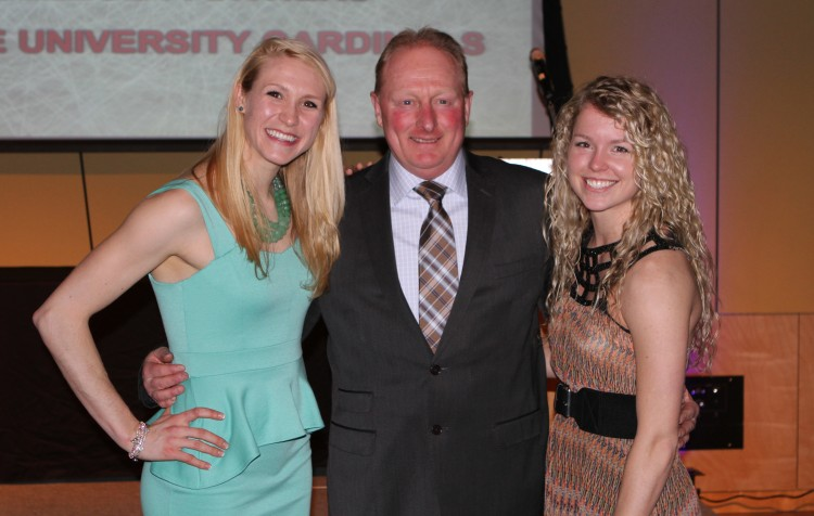 All-Americans Lindsey Hjelm (left) and Kelsey Kennedy (right) with Head Coach Mike Carroll (center).  Photo courtesy of Dan Coquyt `14.