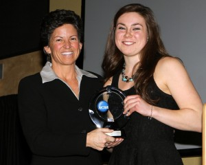 Carolyn Draayer receives the Elite 89 Award from Jan Gentry, the NCAA Assistant Director of Championships. Photo courtesy of Dave Harwig – viewthroughmylens.net.