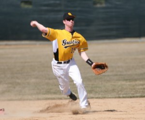Shortstop Max Fidler turns a double play