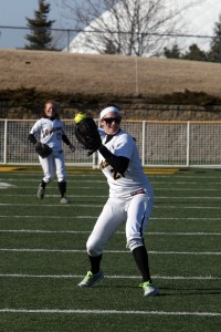 Shelby Nosan scoops and fires to first base. Photo courtesy of Bridget Larson - Sport PiX.