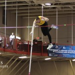 Josh Owens goes over the bar at the 2013 NCAA Championships held in Naperville, Ill.
