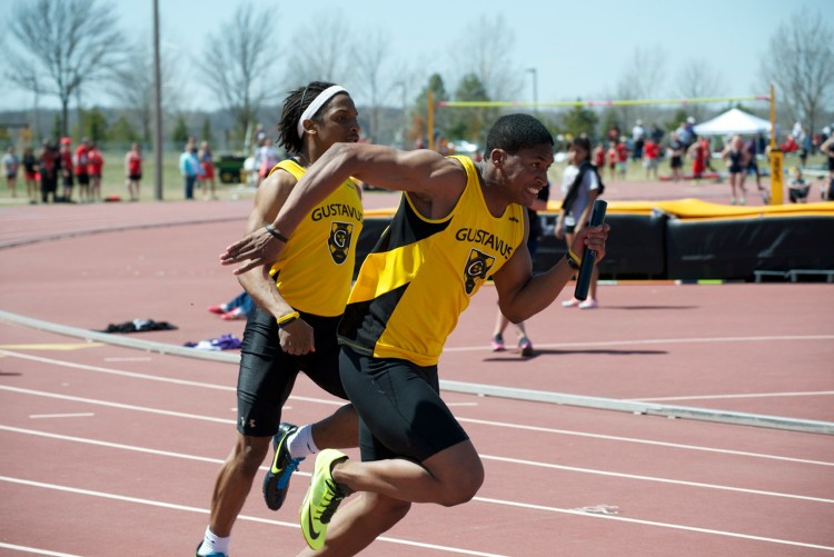 Jeffrey Dubose hands the baton to Blair Riegel.  Photo courtesy of Jeff Hunt.
