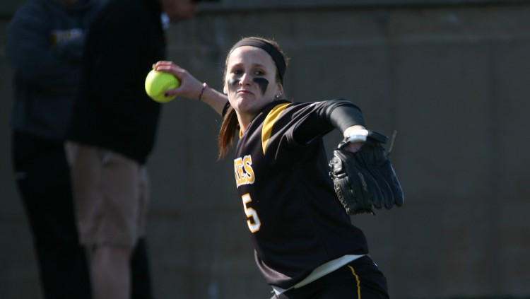 Carly Klass scoops and fires to first base on Thursday afternoon against Carleton.