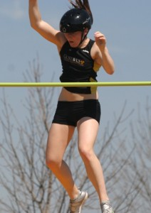 Ally Voss clears the bar at the MIAC Championships last spring.
