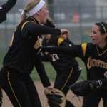 Kailey Morgan and Christina Riester celebrate Friday after Gustavus's win over Carleton.