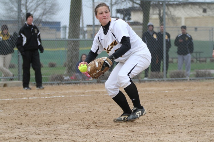 Starting pitcher Jessica Williams fields a bunt and fires it to first base.