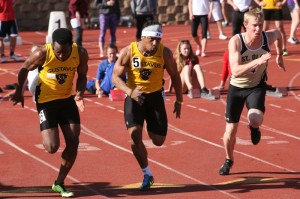 Phillip Butler (left) and Jeffrey Dubose (right) run side-by-side in the 100m dash prelims.