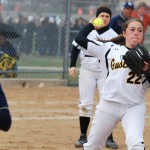 Sarah Rozell picks up a grounder and throws to first base. Photo courtesy of Matt Higgins.