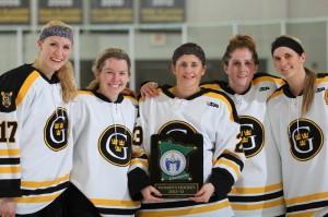 Lindsey Hjelm along with seniors Kelsey Kennedy, Kayla Ingbretson, Meagan Wanecke, and Jenna Christensen with the MIAC Championship plaque.
