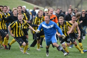The Gustavus men's soccer team celebrates after earning a trip to the NCAA Tournament.