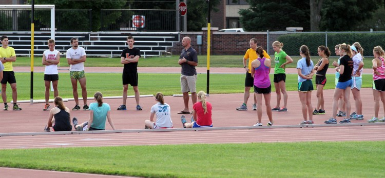 Head Coach Dale Bahr addresses the men's and women's cross country teams prior to practice on Thursday morning.