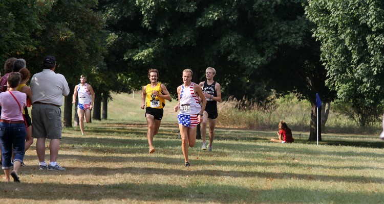 With Nick Ross (right) leading with 200 meters left, Joe Renier (left) begins to make his final surge for the finish line.