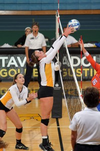 Kelle Nett goes up to make one of Gustavus's 10 blocks.