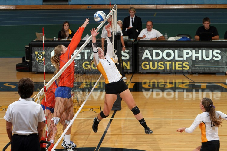 Taylor Meurer reaches over the net for a set in Saturday's 3-1 win over Macalester.  Photo courtesy of Laura Westphal – Sports Pix