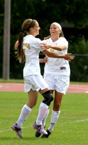Maddison Ackiss and Amanda Cartony celebrate after a goal.
