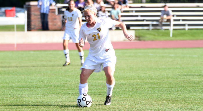 Senior Liz Underwood controls the ball in the midfield.