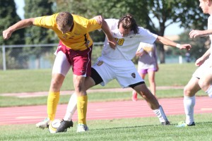 Konnor Tranoris battles Concordia's Nick Koerbitz for possession.
