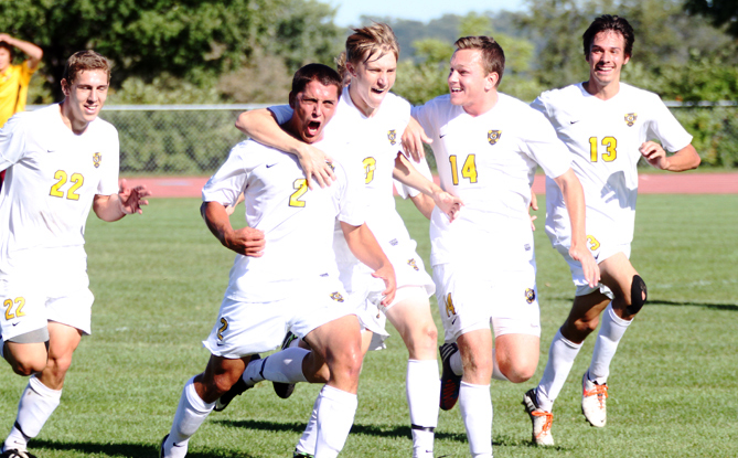 Senior captain Sean Sendelbach mobbed by teammates following what would turn out to be the game-winning goal in Gustavus's 1-0 win over Concordia on Saturday afternoon.