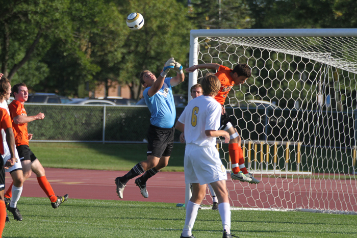 Goalkeeper Brett Ylonen leaps up to clear a cross away from an attacking Wartburg player.  Gustavus suffered a 2-1 loss to the Knights on Tuesday afternoon.
