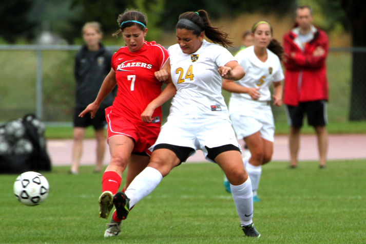 Senior Emily Papagapitos battles for possession with Saint Benedict's Colleen Bouchard. (Photo courtesy of Jessica Williams '16)