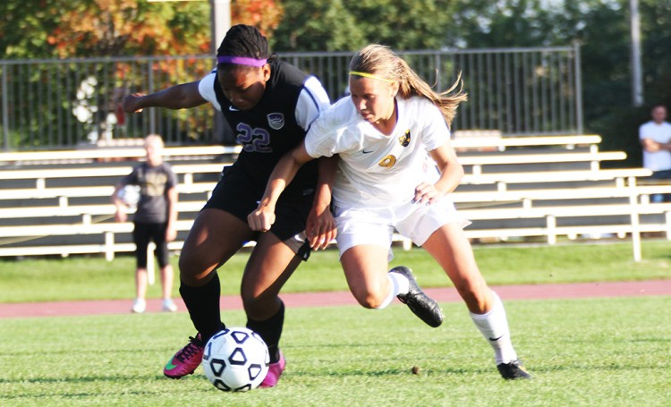 Amanda Cartony battles Crown defender Sabrina Holley in Wednesday's win. (Photo courtesy of Andrew Vold `15)