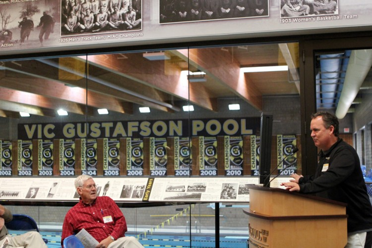 With legendary Gustavus swimming coach Vic Gustafson's name overlooking the pool, Jon Carlson addresses better than 100 Gustavus swimming alumni, family, and friends at Saturday morning's Vic Gustafson pool naming celebration.