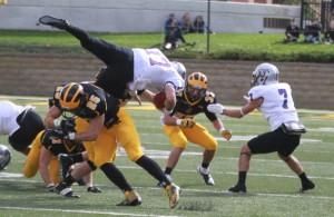 Zach Dilger flips St. Thomas quarterback John Gould.