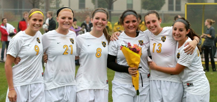 The Gustavus women's soccer seniors (L to R: Amanda Cartony, Liz Underwood, Estee Berg, Emily Papagapitos, Leah Brossoit, and Ana Gleason).