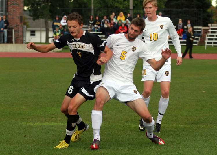 Gustavus's Zach Schmith battles with St. Olaf top scorer, Kevin Skrip, in Saturday's 2-1 win over St. Olaf.