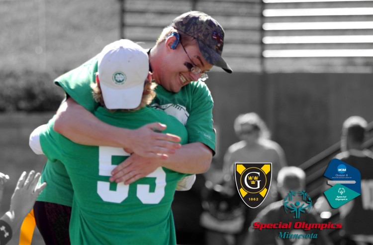 Mike Broker of the Mankato LEEP Vikings jumps into Ethan Armstrong's arms in celebration of a victory at the Special Olympics Unified Flag Football Tournament held at Gustavus in late September.