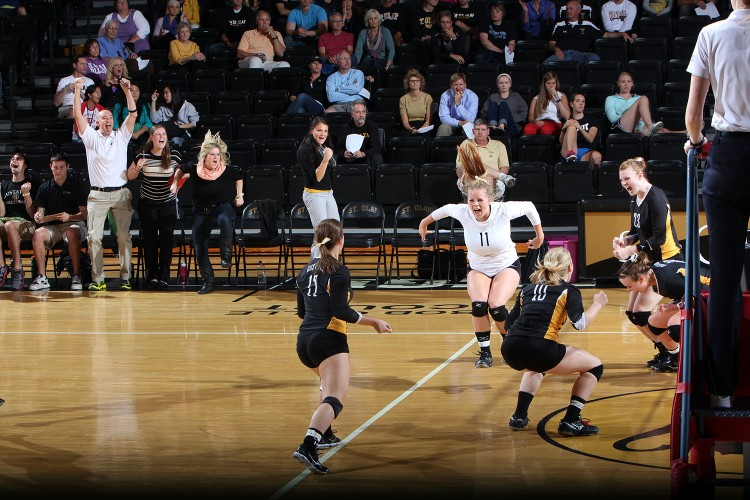 The Gustavus volleyball team celebrates a point in its 3-1 win over St. Olaf on Wednesday night in Northfield.  Photo courtesy of the St. Olaf Sports Information Department.
