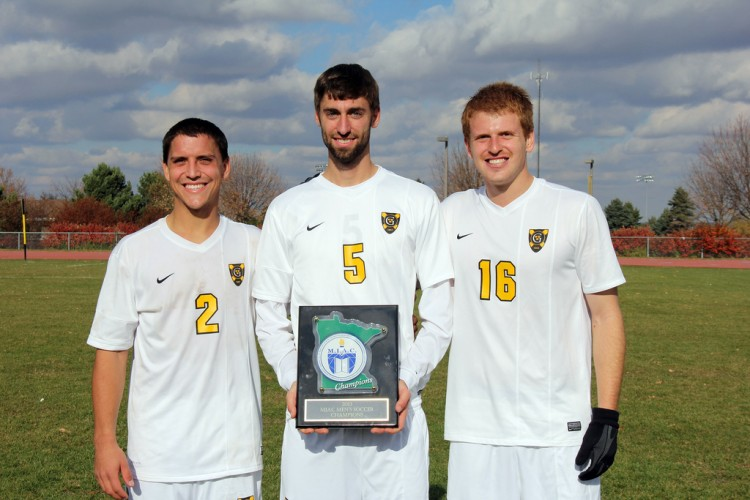 Seniors Sean Sendelbach, Zach Schmith, and Casey Gilbert hold the 2013 MIAC Championship plaque after Saturday's 2-0 win over Hamline.
