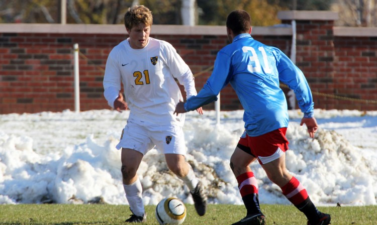 Charlie Adams looks to get around Saint John's Ryley Sullivan in Wednesday's 2-1 loss to Saint John's.